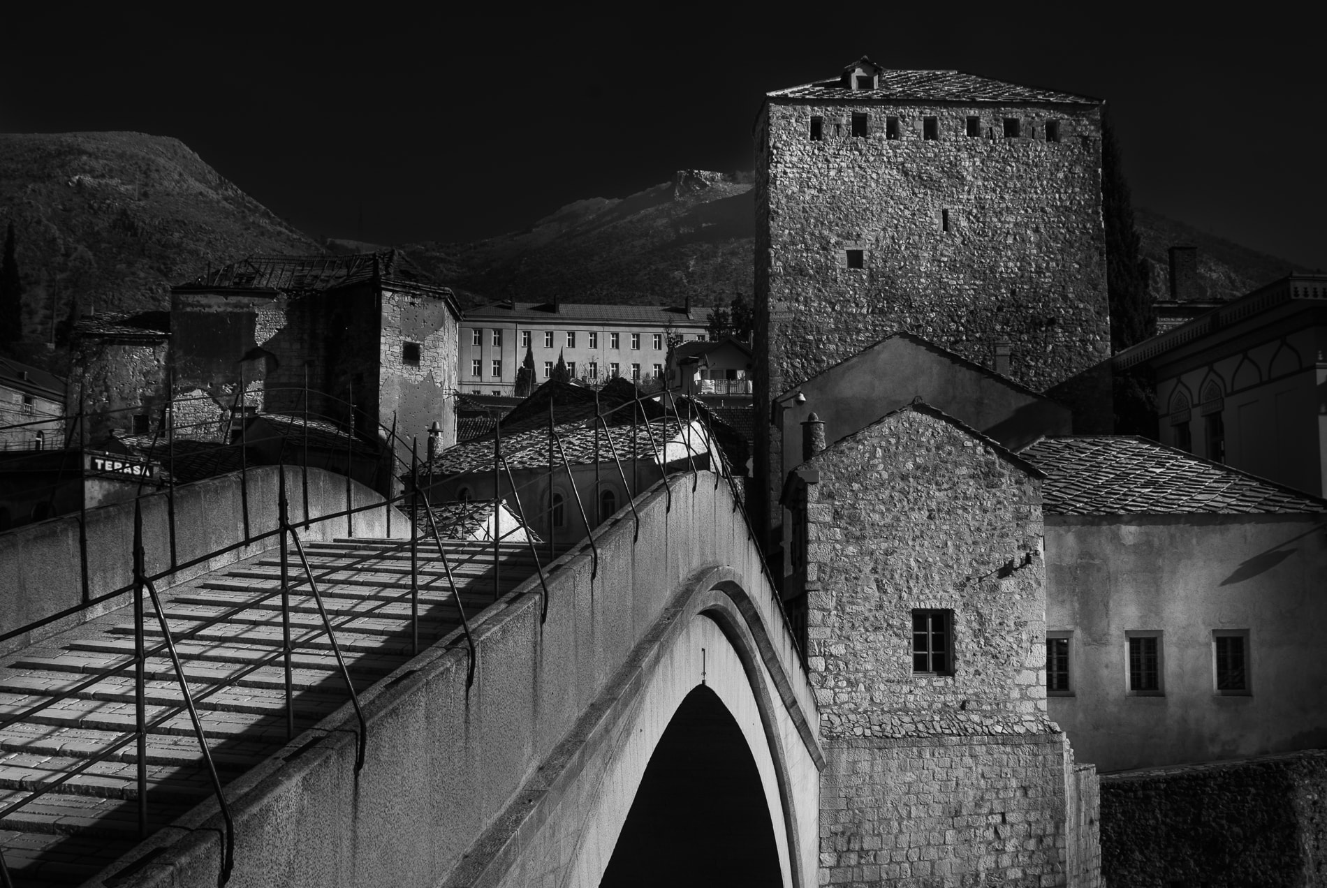 Black and white photograph of Looking across the 'old bridge' or Stari Most, Mostar, Bosnia and Herzegovina