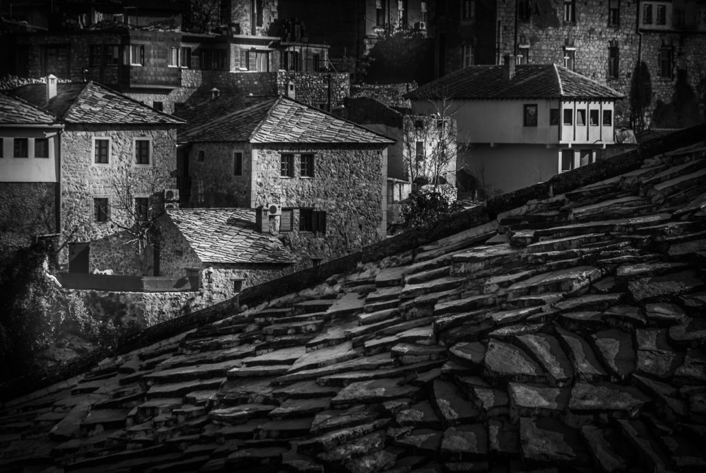 Looking across rooftops. Mostar, Bosnia and Herzegivina. Black and white photograph, converted in Lightroom.