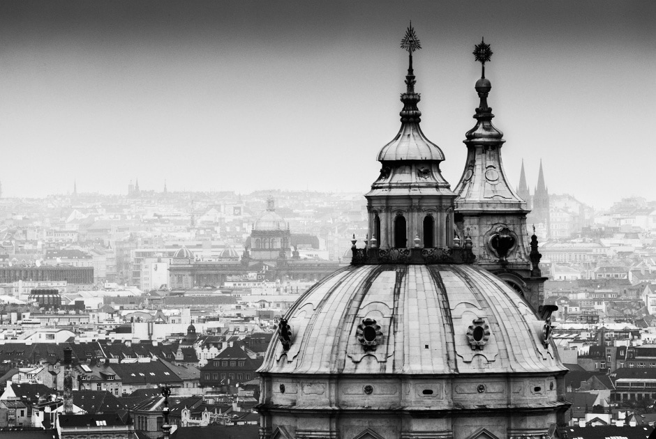 Black and white photograph of the dome of St Nicholas Cathedral in Prague, Czechia