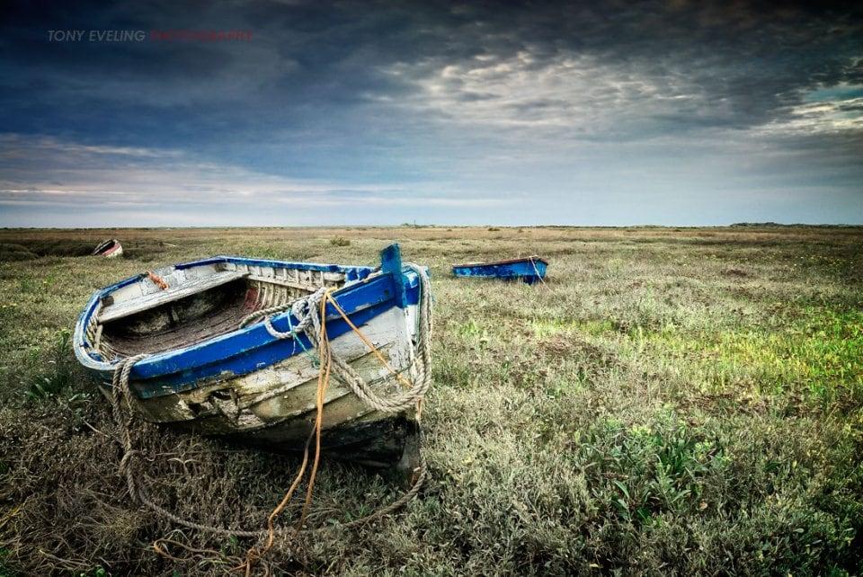 fishing boat at low tide, North Norfolk, England, UK