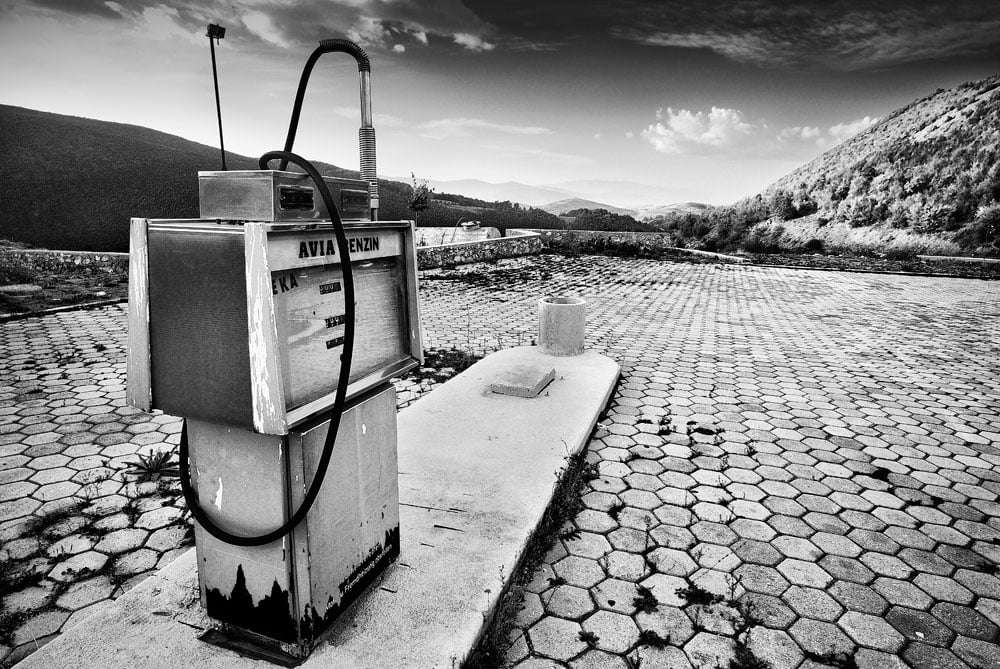 Black and white photo of a disused petrol station in Macedonia.