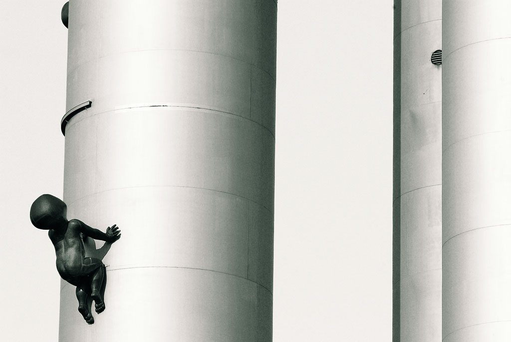 Black and white photograph of David Cerny's Baby Sculptures climbing th eZizkov Tower in Prague, Czechia