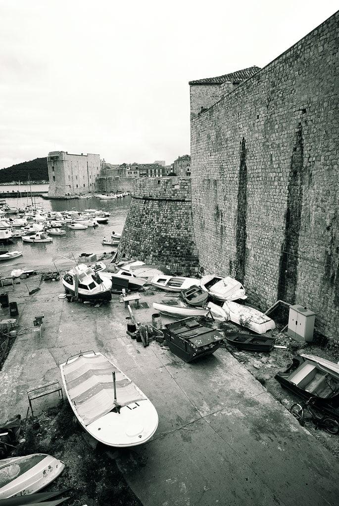 Boats moored around Dubrovniks city walls, Croatia