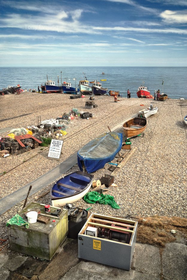 Fishing boats moored on the beach at the town of Beer in Devon, England, UK