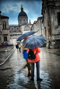 Tourists and umbrellas in Dubrovnik old town, Croatia
