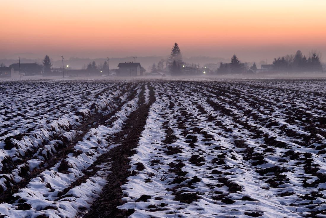 Plughed fields under snow in wintertime, Slovenia
