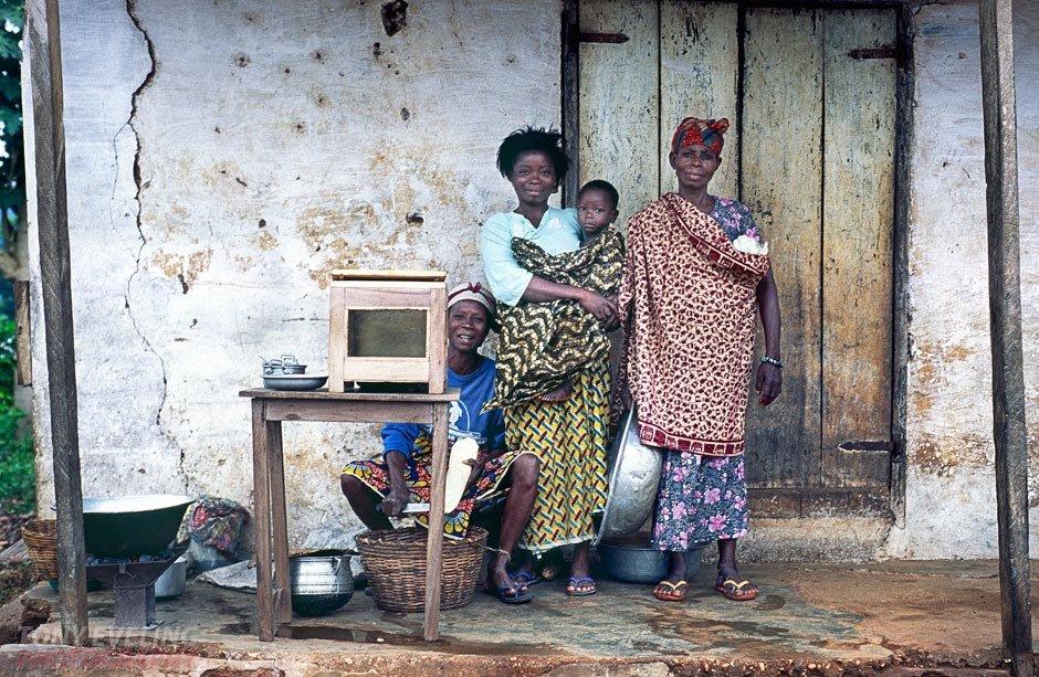 Family posing for a photograph. Volta region, Ghana, West Africa