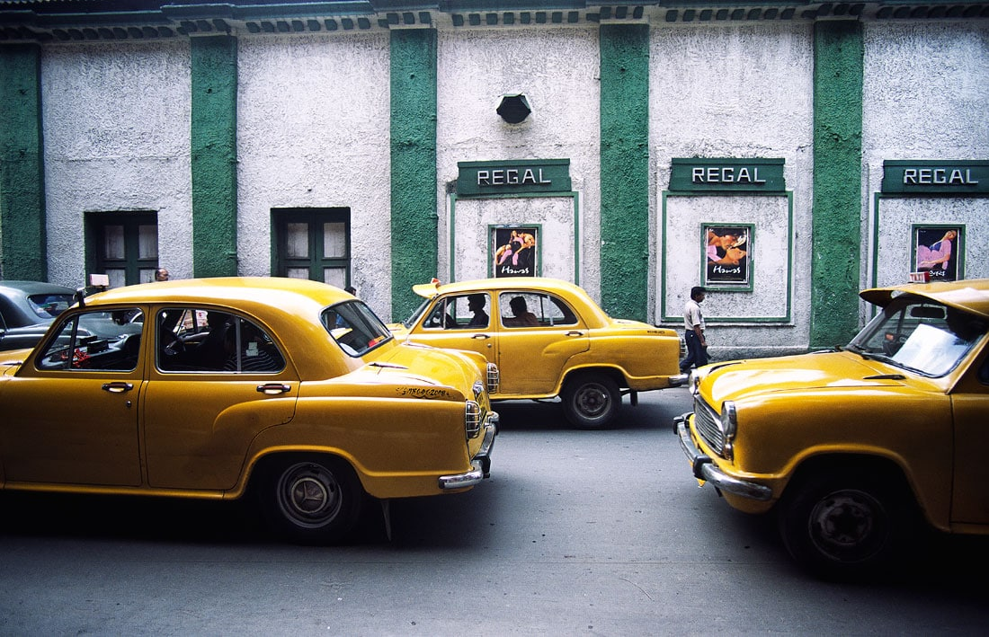 Yellow ambassadore taxis outside the regal cinema in Kolkata, West Bengal, India