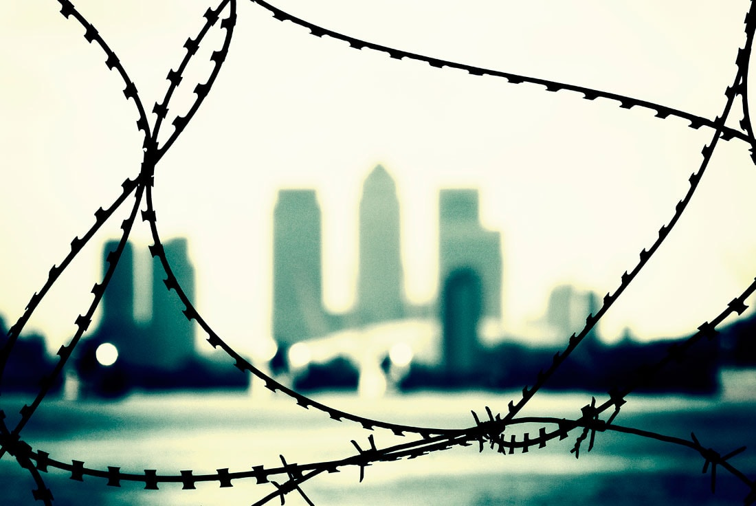 Canary Wharf through barbed wire, london, england, uk