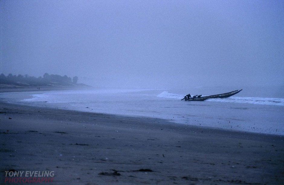 Fishermen on the beach in The Gambia, at dawn