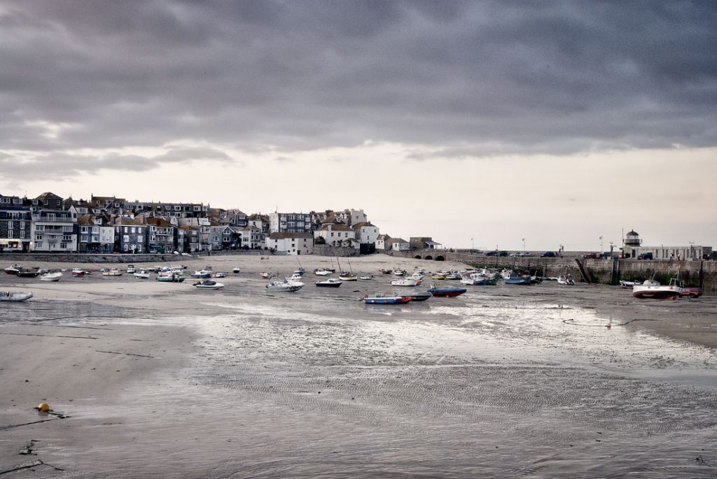Moored boats at low tide, in st ives harbour, Cornwall,england,uk