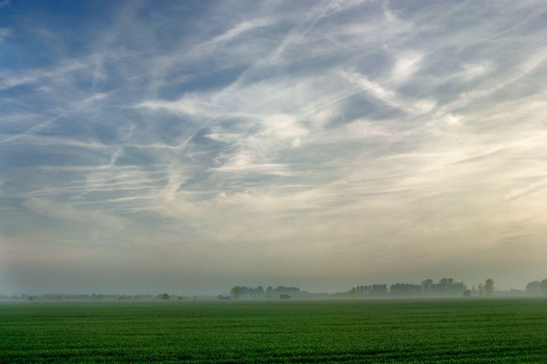 Vapour trails over dawn skies, Littlehampton, West Sussex, England, UK