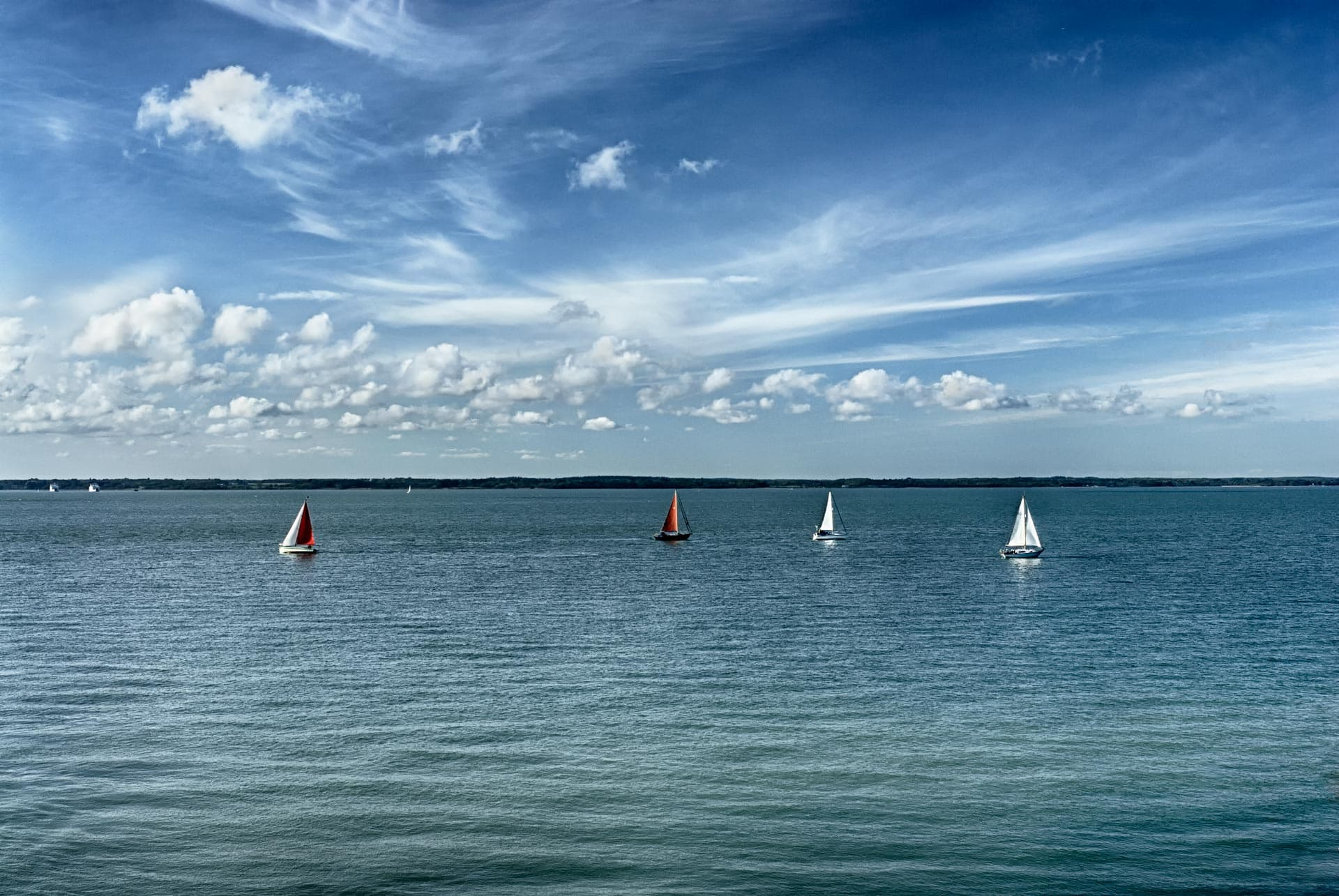Yachts off the coast at Cowes, Isle of Wight, England, UK