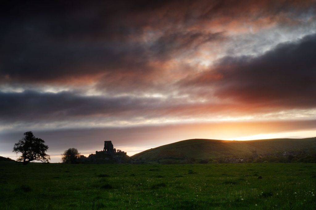 Corfe castle in silhouette, early morning.  Dorset, England, UK