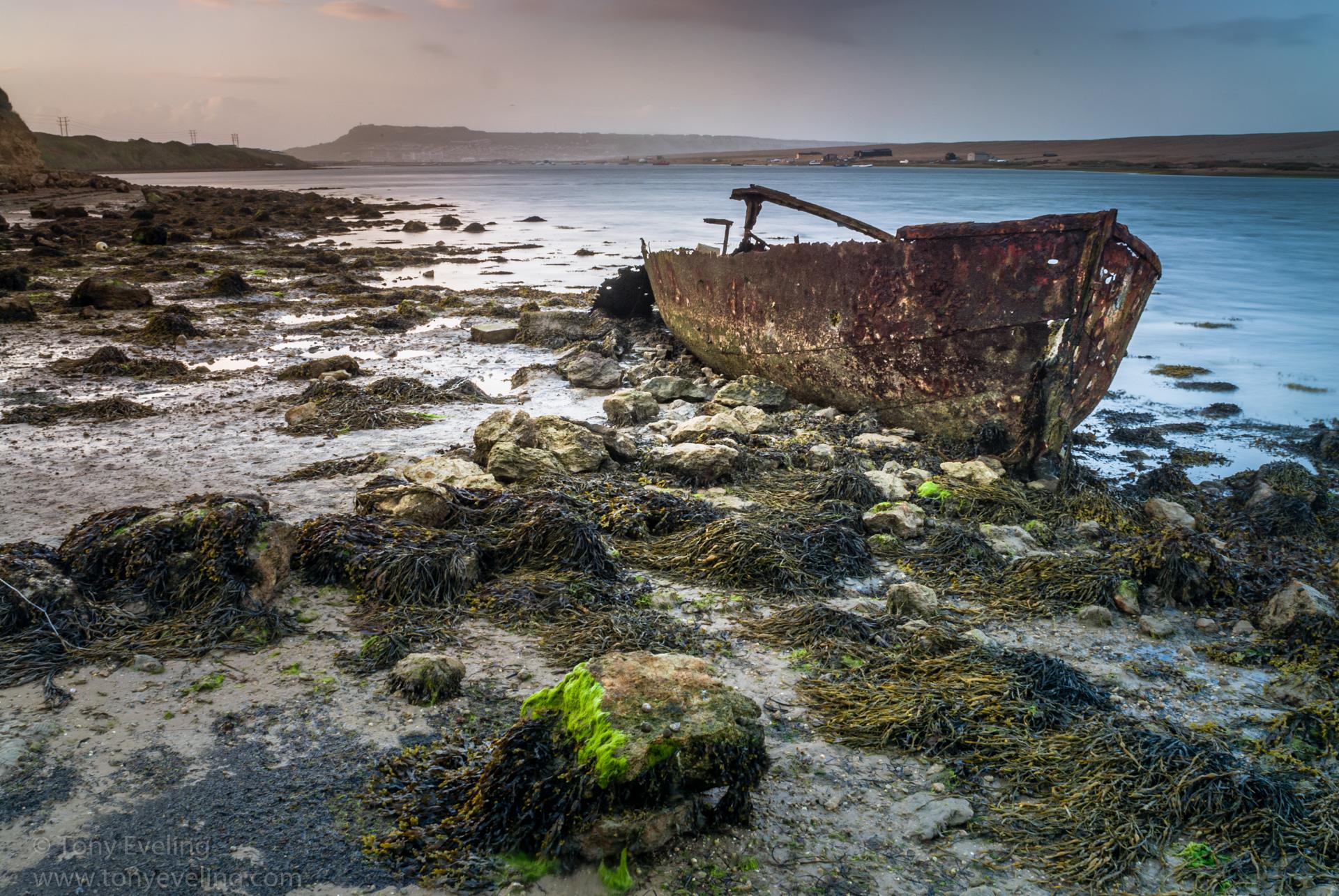 Rusty old boat abandoned in Fleet L:agoon, Chesil Beach, Dorset