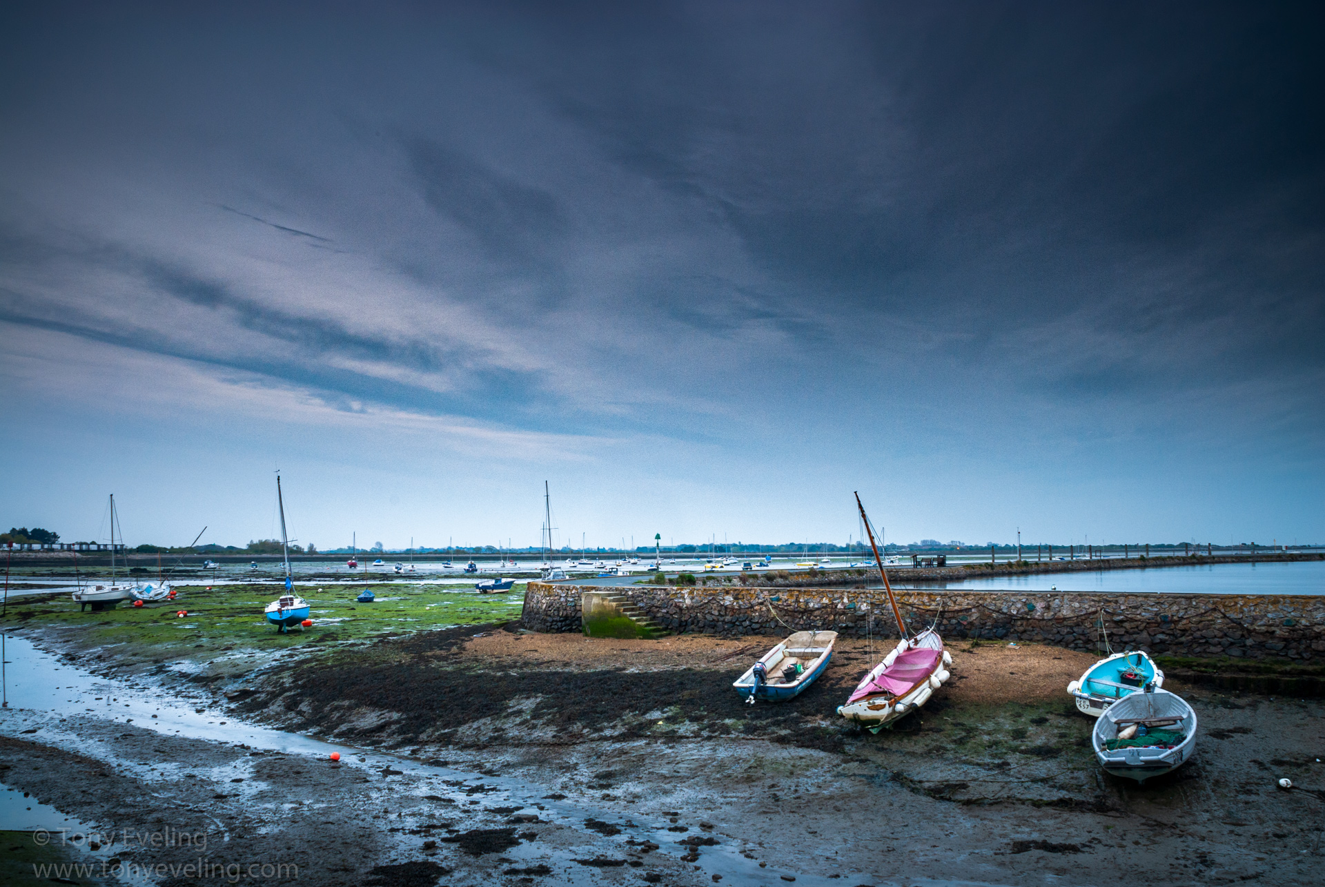 Boats moored at low tide