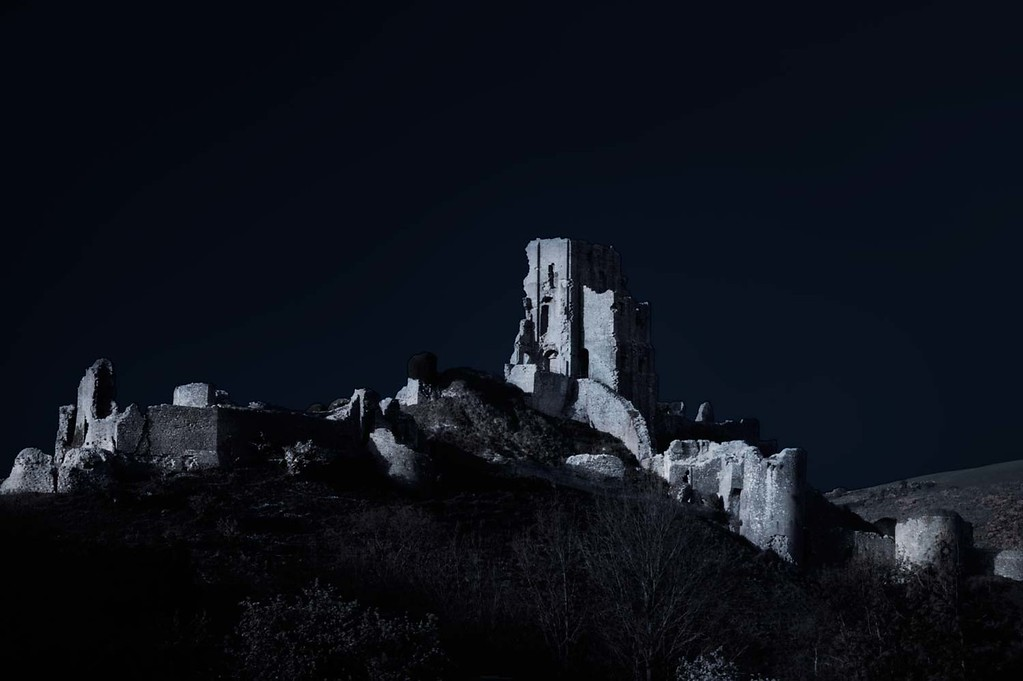 An example of a photograph taken in the day and converted in Photoshop into a night time shot. Corfe Castle, Dorset, England, UK