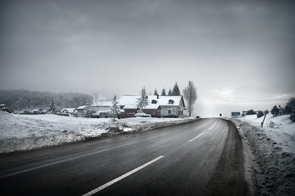 Top of a mountain pass in Bosnia. Winter scene with dark moody clouds.